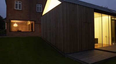 Exterior Of Modern House With Extension At Night